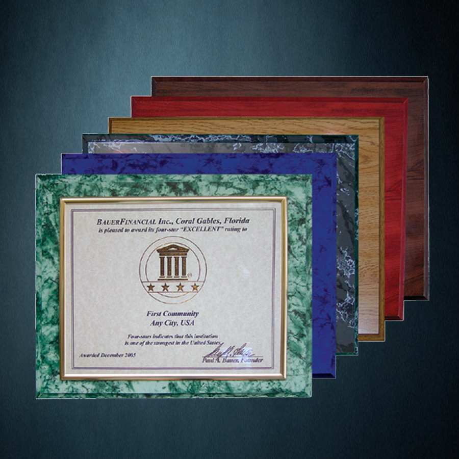 4 Star Award pictured in a green marble plaque with the othe rplaque colors behind it