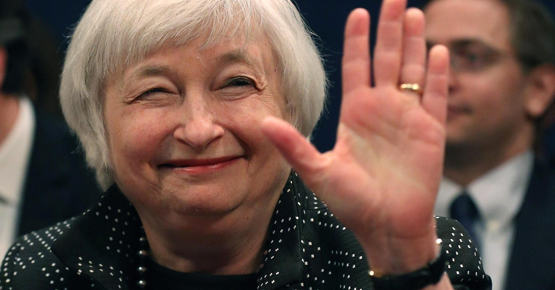 Janet Yellen waives goodbye with a smile on her face