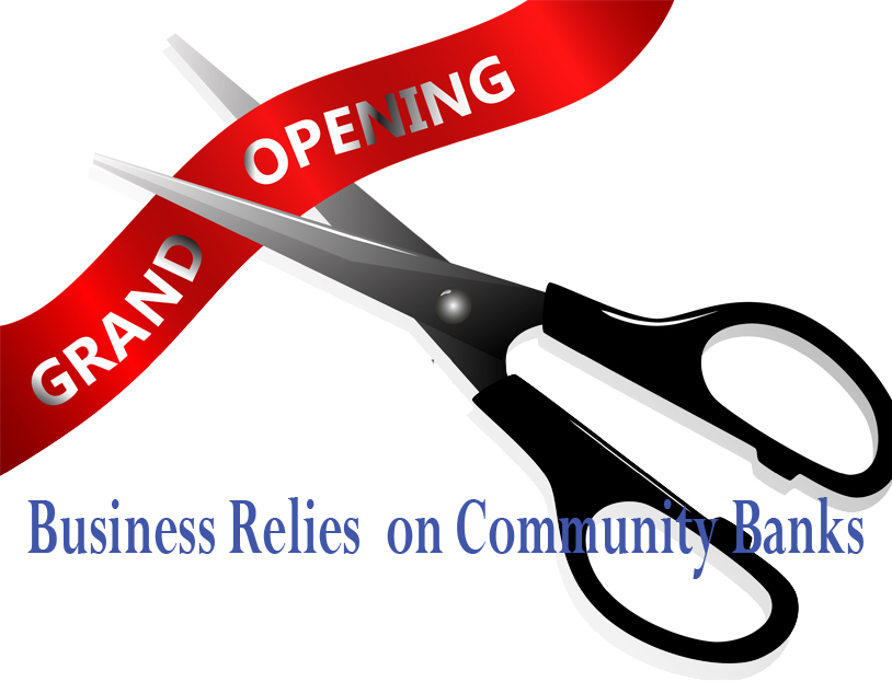 Scissors cutting a red ribbon at a grand opening