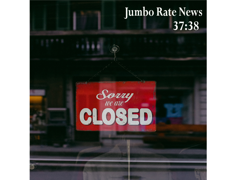 "Store front with a sign saying ""Sorry, we're Closed"""