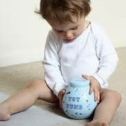 Child With Piggy Banks